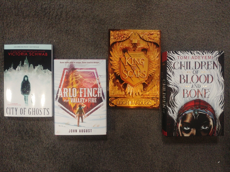 I got the King of Scars sampler, an ARC of City of Ghosts signed by VE Schwab, and two signed books from the signing event!